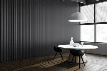 Round table in dark gray cafe