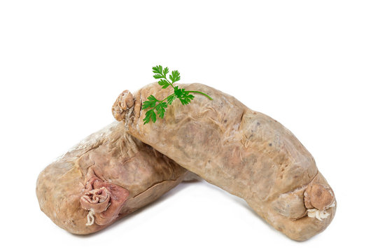 andouillette: French typical sausage from pork intestine on a white background