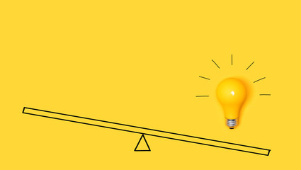Wall Mural - Idea light bulb on a scale on a yellow background
