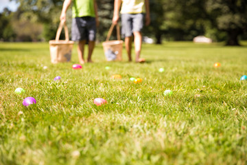 easter eggs hunt. Blurred silhouettes of children with baskets in hands. the concept of family fun at Easter.  blurred background. Cope space for your text