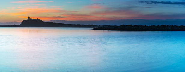Breakwalls, Lighthouse and Sunrise Seascape Panorama