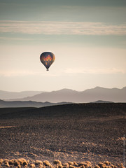 hot air balloon in the mountains