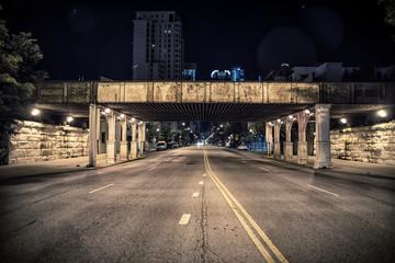 Fototapete - Vintage city railroad bridge at night