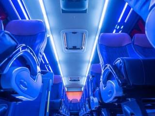 Transportation of people on buses. Seat in the bus. Bus service.