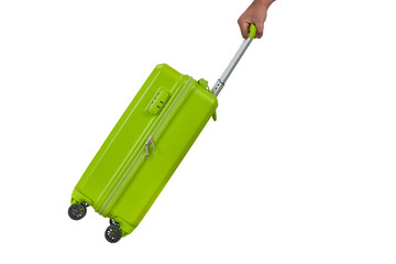 hand on green light luggage with white isolate background Wall mural