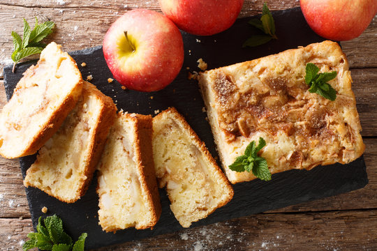 Delicious homemade apple bread with cinnamon and mint close-up. horizontal top view