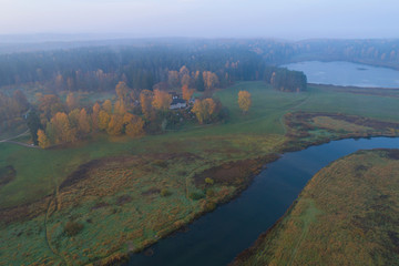 Papiers peints Beige A view from the height of the Mikhailovskoe on a foggy October morning (shooting from a quadrocopter). Pushkinskie Gory, Russia