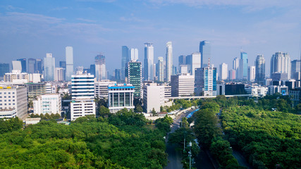Scenery of trees and skyscrapers in Jakarta