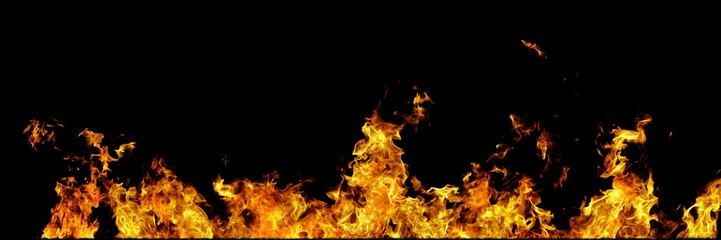 Real line of fire flames isolated on black background. Mockup on black of wall of fire.