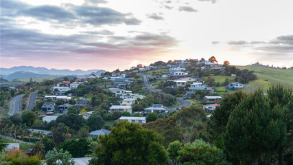 colorful sunrise over mangonui town in New Zealand