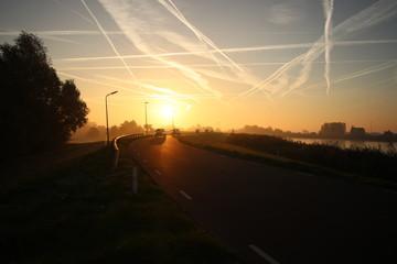 sunset over the river Hollandsche IJssel at Moordrecht in the Netherlands