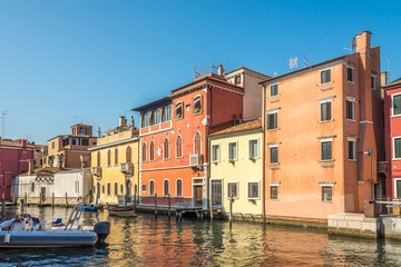 View at the colored buildings on the Vean canal in Chioggia - Italy