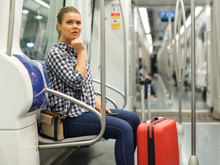 Woman traveling in subway car