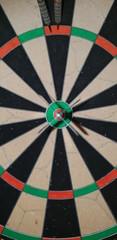 darts on a bullseye target