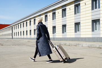 blonde girl with a suitcase, travel