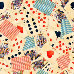 A lot of detailed colorful poker cards with old paper texture, vintage seamless pattern