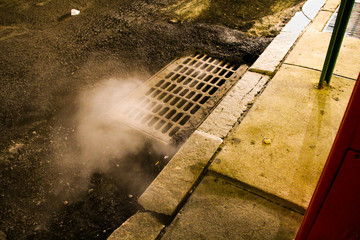 Steam rising from a sewer in Manhattan, New York