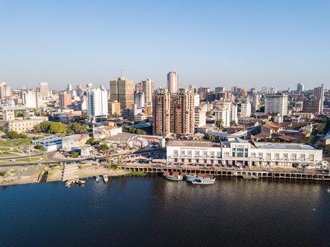 Panoramic view of skyscrapers skyline of Latin American capital of Asuncion city, Paraguay. Embankment of Paraguay river. Birds eye aerial drone photo. Ciudad de Asunción Paraguay.