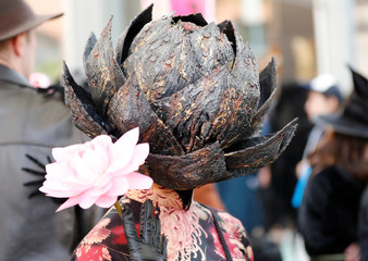 A participant in costume poses for a photo during a Halloween event in Kawasaki