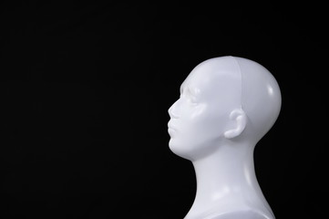 isolated white mannequin or doll human head on black background for health
