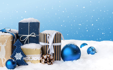 Christmas gift boxes in snow.