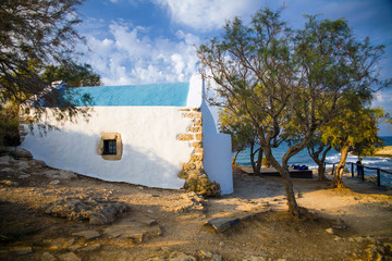 Traditional Greek chapel on the hill. A small Greek church by the sea. A tourist attraction on Crete in Greece.
