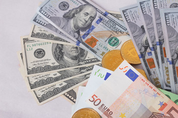 golden bitcoins new virtual currency with traditional dollars and euro as a background
