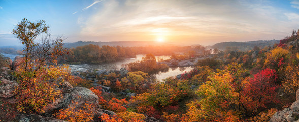 Fotorolgordijn Diepbruine amazing panoramic view of blue foggy river and colorful forest on sunrise. autumn landscape