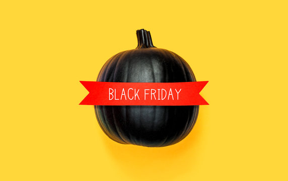 Black Friday with a black pumpkin with a red banner