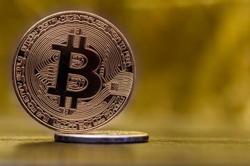 Bitcoin closeup on a golden background.