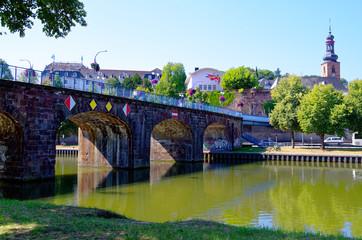 Old bridge in german Alte Brücke in Saarbrücken with the Saarbrücken castle in the background with the Saar