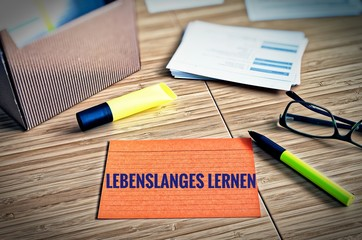 Index cards with legal issues with glasses, pen and bamboo with the german words Lebenslanges Lernen in english lifelong learning