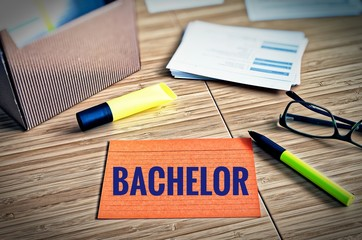 Index cards with legal issues with glasses, pen and bamboo with the word Bachelor