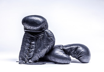 Wall Mural - Old boxing gloves on a white background
