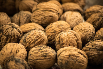 Closeup of a pile of walnuts. Scattered pile of walnuts. Background. Fresh walnuts