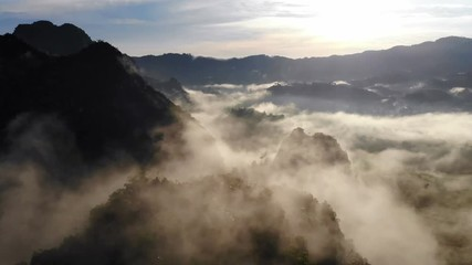 Wall Mural - Aerial view of Morning mist at mountains.