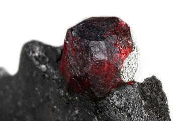 Macro mineral stone garnet  in the rock on a white background