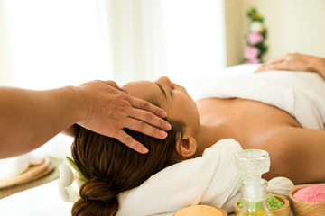 Beautiful woman lying in spa salon,receiving head massage,, relaxing and lying in spa girl Health care concept.