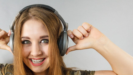 Teen women wearing headphones