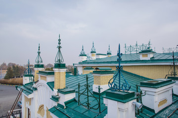 The roof of the old railway station in the city of Turkestan in Kazakhstan. The roof is made of metal. Roof with turrets. Roof of the late nineteenth century. Old Railway Station in Turkestan