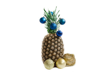 pineapple on a white background with blue Christmas decorations