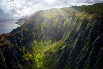 Landscape view of Na Pali coastline cliffs with sunlight glow, Kauai, Hawaii Wall mural
