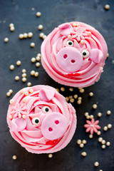 Miss piggy cupcakes - beautiful and delicious cakes decorated with pink cream shaped funny piggy faces, christmas and new year 2019 themed treat for kids party