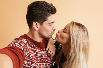 Portrait of a happy young couple dressed in sweaters