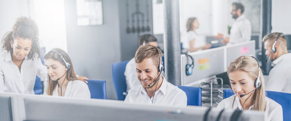 Call center worker accompanied by his team.