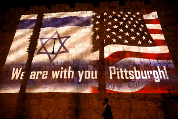 "An image of Israeli and American flags with the wording, ""We are with you - Pittsburgh"" is projected on the walls of Jerusalem's Old City, in solidarity with the victims of a synagogue shooting in Pittsburgh"