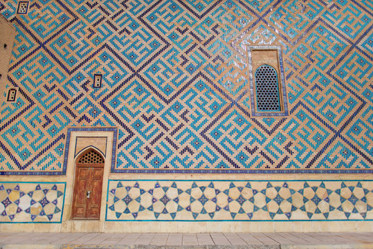 The Mausoleum of Khawaja Ahmed Yasawi. Ancient mosque in the city of Turkestan. UNESCO World Heritage Site in Kazakhstan. Ancient wall painting of the mausoleum. Glazed wall paintings.
