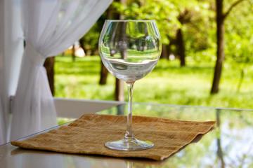 empty goblet on high stalk empty in gazebo