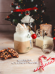 Mug with hot chocolate drink and marshmallows on the top. Christmas colorful still life. Cozy festive mood.