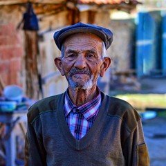 close-up portrait of happy senior man looking at camera. Old Turkish Man Portrait who lives in a small town of Turkey.